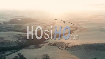 Rollling Hills Of British Countryside At Frosty Sunrise - Video Drone Footage