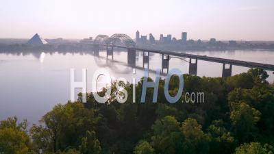 Business District Memphis Tennessee Across The Mississippi River With Hernando De Soto Bridge Foreground - Aerial Video By Drone