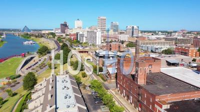 Mixed Use Industrial District Of Memphis Tennessee With Apartments, Condos And Converted Old Warehouses. Downtown City, Pyramid And Bridge Background - Aerial Video By Drone