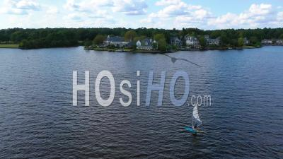 Kite Boarder Near Luxury Homes, Real Estate And Mansions On Ross R Barnett Reservoir Near Old Trace Park, Jackson, Mississippi - Aerial Video By Drone