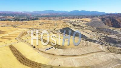 A Massive Vast Giant Tract Home Contruction Project Development In The Hills Above Santa Clarita, California Suggests Los Angeles Urban Sprawl - Aerial Video By Drone