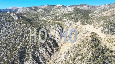 Aerial Over A Mountain Road Along A Ridge In The Eastern Sierra Mountains Near Lone Pine And The Owens Valley California. - Drone Point Of View