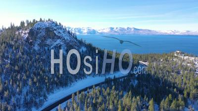 2020- Aerial Video Of Highway 50 Approaching Lake Tahoe In Snow And Winter With Traffic On Highway Below - Drone Stock Footage
