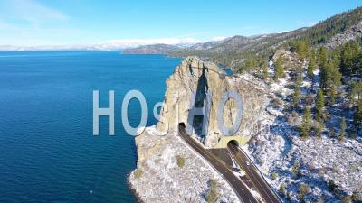 2020- Winter Snow Aerial Cave Rock Tunnel Along The Eastern Shore Of Lake Tahoe, Nevada, With Road And Traffic Below - Drone Stock Footage