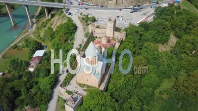 2019 - Aerial Video Around A Beautiful Castle And Church On Lake Zhinvali In The Republic Of Georgia - Drone Stock Footage