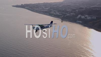 Cessna 172 Flying Over Sea And Coastline