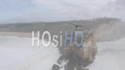Flying Around Nazare Lighthouse And Public Watching Waves - Video Drone Footage