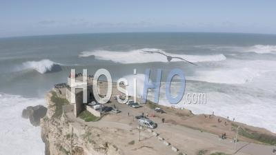 Big Waves Breaking In Front Of Nazare's Lighthouse - Video Drone Footage