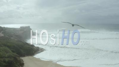 Flight Over Praia Do Norte And Nazare's Lighthouse - Video Drone Footage