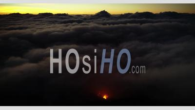 Over The Clouds With Volcano Eruption - Video Drone Footage