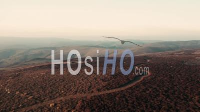 Winter Sunset Light Over Scenic Hills - Video Drone Footage