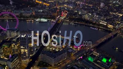 London Eye, Southbank, River Thames And Waterloo Railway Station At Night, London Filmed By Helicopter