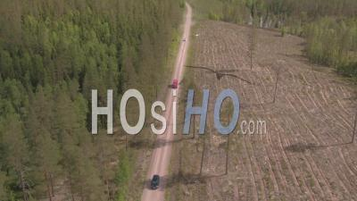 Three Cars Driving On A Track In The Middle Of A Forest, Tackasen, Sweden - Video Drone Footage