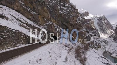 Two Cars Getting Out Of A Tunnel In The Alps Mountains, Tignes, France - Video Drone Footage