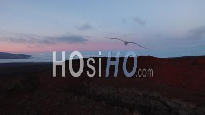 Aerial View Of Red Volcanic Hills In The Sunset, Mauna Loa Volcano, Hawaii - Video Drone Footage