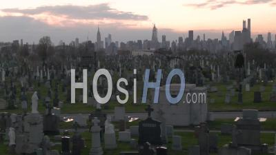 Rising Aerial Of Vast Cemetery In New York City Suggests Victims From Coronavirus Covid-19 Pandemic Epidemic Outbreak Deaths. - Video Drone Footage