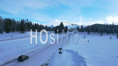 2020 - Aerial Of Cars Driving Travel On Icy Snow Covered Mountain Road In The Eastern Sierra Nevada Mountains Near Mammoth California. - Video Drone Footage