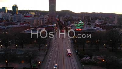 Moody Aerial Past Portland Oregon Stag Deer Sign And Downtown Old Town Cityscape And Business District At Sunset Or Dusk. - Video Drone Footage