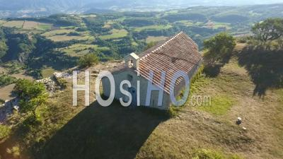 Litlle Church On The Top Of A Cliff Over Fields, Forests And Mountains, France - Drone Point Of View