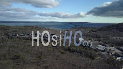 Laboratory In The Middle Of A Forest Near A Lake, Maine, Usa - Drone Point Of View
