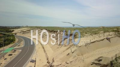 Aerial View Of The Ocean Beach And Hossegor Lake - Video Drone Footage