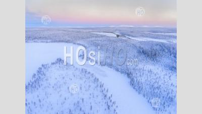 Aerial Drone Photo Of Snow Covered Lake And Forest Winter Landscape Showing Amazing Lapland Scenery In Scandinavia In Finland