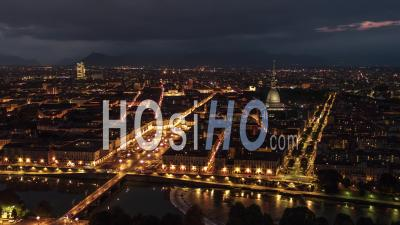 Establishing Aerial View Shot Of Turin It, Mole Antonelliana On The Horizon, Torino Skyline, Italy At Night Evening - Video Drone Footage