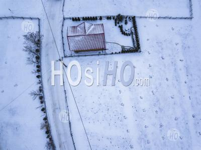Snowy Covered House In The Carpathian Mountains, Bran, Transylvania, Romania - Aerial Photography