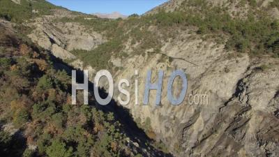 Ravine At The Lac De Serre-Poncon Lake, French Alps, France - Video Drone Footage