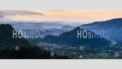 Typical Slovenia Landscape. Misty Sunrise View From Osojnica Hill At Lake Bled Towards Radovljica, Slovenia, Europe