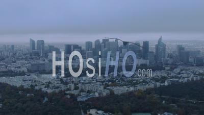 Aerial Footage Of La Defense Business Center Under A Cloudy Sky, Seen From Helicopter