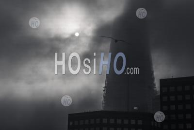 Black And White Shard In London With Dramatic Moody Clouds And Mist Moving With Sun Rising On A Misty Foggy Day In London, Shot In Covid-19 Coronavirus Lockdown In England, Europe