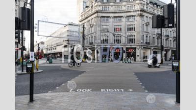 London In Covid-19 Coronavirus Lockdown With Quiet Empty Roads At Oxford Street And Oxford Circus, With Closed Shops Shut Down At The Popular Shopping High Street In The Pandemic In England, Europe