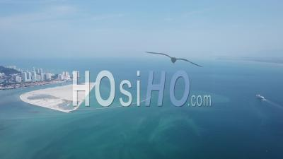 Aerial View A Cruise Ship Is Move At Penang Sea Near Reclamation Island - Video Drone Footage