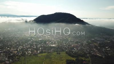 Aerial Panning Berapit Town Over The Thin Fog At Malaysia - Video Drone Footage