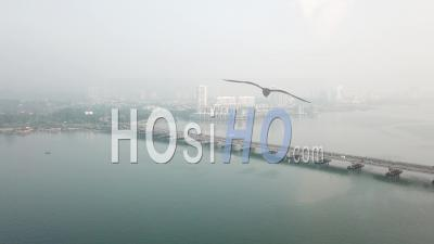 Fly Toward Penang Bridge With Background The Light Condo - Video Drone Footage