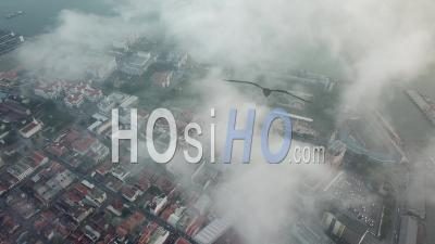 Aerial View Morning Fog Surrounds George Town World - Video Drone Footage