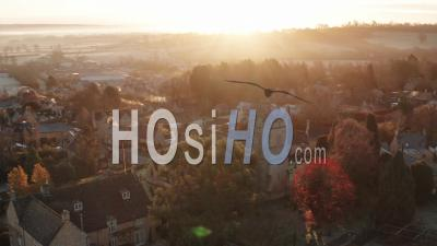 Aerial Drone Video Of Typical English Village And Beautiful British Countryside Scenery In The Cotswolds Showing A Rural Church At Sunrise In Morning Sun At Longborough, Gloucestershire, England, United Kingdom