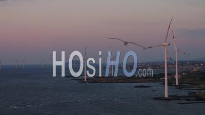 Jeju Island, South Korea, Sunset, Wind Turbine - Video Drone Footage
