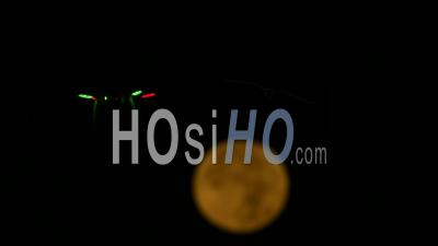 Drone In The Front Of The Full Moon