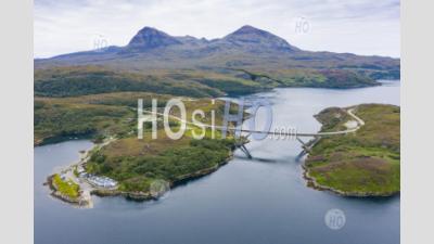 Aerial View Of Kylesku Bridge Crossing Loch Chairn Bhain In Sutherland, Scotland, Uk - Aerial Photography