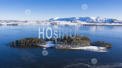 Aerial View Of A Snow Covered Loch Leven Castle Situated On Small Island On Loch Leven, Kinross-Shire, Scotland, Uk - Aerial Photography