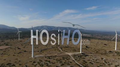 Wind Turbine On Corbieres Hills Under The Spring Sun - Video Drone Footage