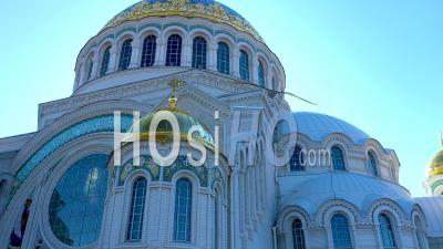 Kronstadt Naval Cathedral View Of Golden Domes, Mosaics And Stained Glass Windows. Raising The Camera To The Very Top To The Cross - Video Drone Footage