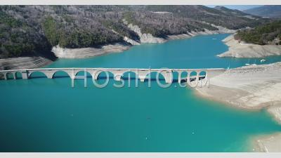 The Old Abandoned And Flooded Bridge Of Chanteloube Bay, Serre Poncon Lake, Hautes-Alpes, France, Viewed From Drone