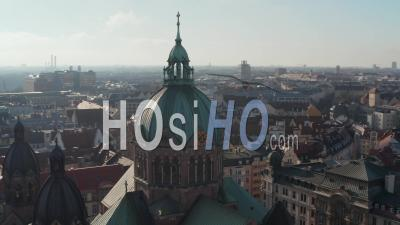 Close Up Aerial View Of Cathedral Church Top With Christian Cross And Clock On Tower, Beautiful Old Architecture In Munich, Germany, Drone Slide Circle Around Building