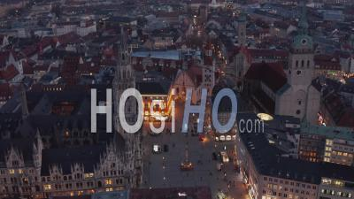 Beautiful Marienplatz Famous City Square In Center Of Munich, Germany After Sunset With Scenic City Lights And New Town Hall, Aerial Wide Angle View - Video Drone Footage