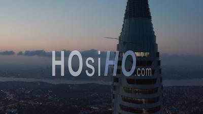 Circling Istanbul Skyscraper Skyline In The Distance Next To New Tv Tower From Epic Aerial Perspective At Dusk, Slide Right - Video Drone Footage