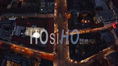 Flight Over Typical Neighborhood In Munich, Germany Beautiful Winter Vibe At Night With City Lights And Traffic Glowing, Aerial Birds Eye Overhead Top Down View - Video Drone Footage