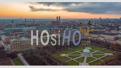 Munich, Germany Cityscape With View Of Frauenkirche Cathedral And Beautiful Old City Architecture With Sun Setting, Aerial Hyper Lapse, Moving Time Lapse Above Big German City - Video Drone Footage
